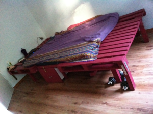 Pallet furniture: double bed, assembled from one euro pallet, one disposable pallet