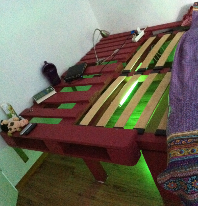 Double Bed Made Of Pallets And Timber Beams Neon Illumination