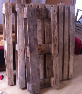 Untreated pallets after cleaning - half an euro-pallet, one disposable pallet and another euro-pallet