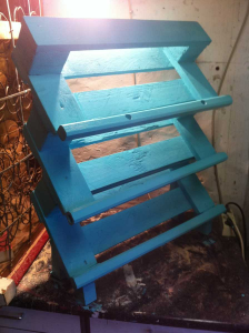 Shoe rack made of pallets: front view, painted