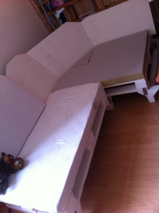 Final sofa assembling: cushioning the sofa corner