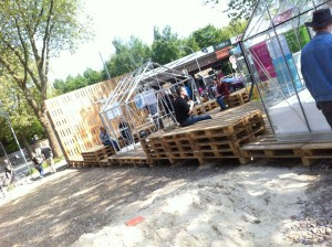 Pallet stage, populated and with exhibition pavillons