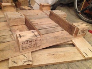 Tabletop pallet with wood scraps on spacers, below