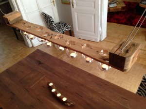 Hanging pallet candle holder, lit from above