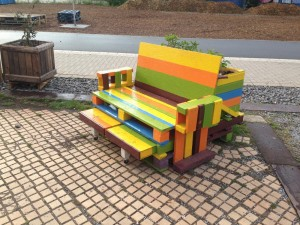 Large pallet chair, coloured and with extendable footrests